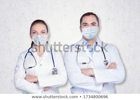 Jovem masculino feminino médico máscara Foto stock © Imaagio