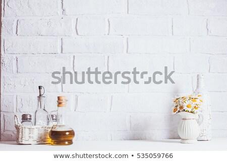 Daisy flowers on kitchen counter Stock photo © dashapetrenko