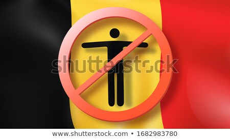 Warning sign with crossed out man on a background Belgian flag. Stock photo © artjazz