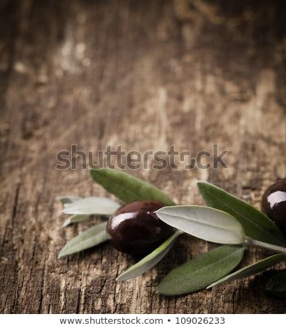 Olive branch on wooden table Stock photo © dashapetrenko