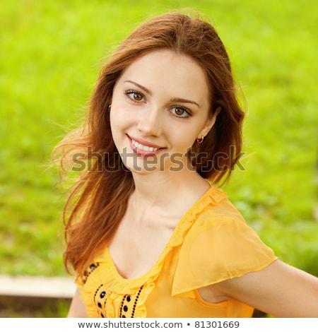 Sorridere attrattivo rilassante panchina città Foto d'archivio © deandrobot