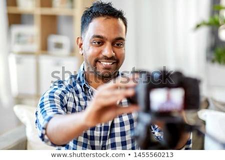 Stock photo: Indian Male Video Blogger Adjusting Camera At Home