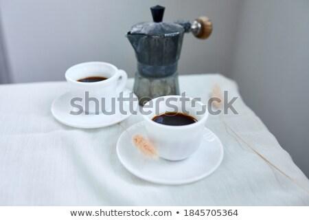 Twee koffiekopjes Italiaans koffiezetapparaat tabel home Stockfoto © Illia