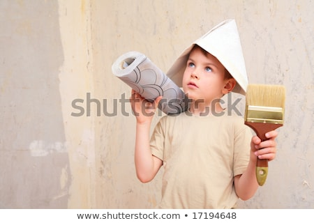 boy with brush and roll of wallpaper in papper hat Stock photo © Paha_L