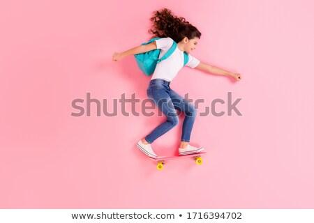 Teenage school girl with rucksack and happy smile Stock photo © darrinhenry