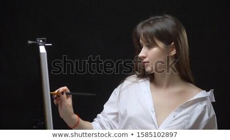 Woman holding a paintbrush Stock photo © photography33