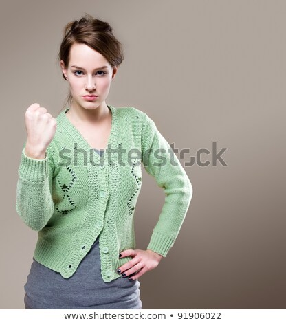 Extremely aggressive looking young woman. Stock photo © lithian