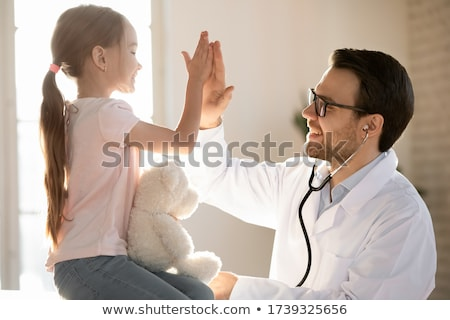 Male doctor holding patients results Stock photo © photography33