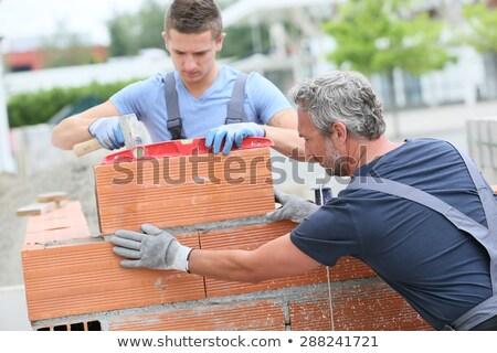 Kamieniarstwo uczeń szkoły mężczyzn cementu dwa Zdjęcia stock © photography33