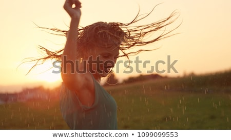 Young smiling blonde girl dancing  Stock photo © dashapetrenko