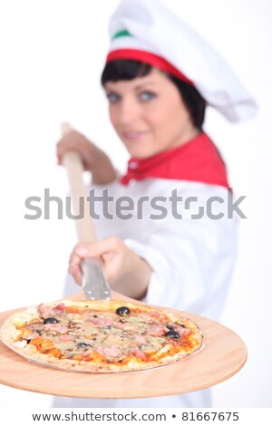 Pizza maker displaying her pizza Stock photo © photography33