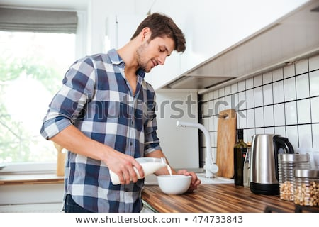 Young man drinking out of a bowl stock photo © photography33