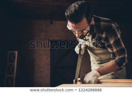 portrait of a man sawing stock photo © photography33