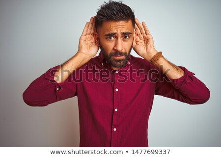 A young man with hearing problems. Stock photo © photography33