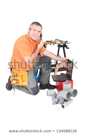 Stock photo: Plumber with materials, laptop and cellphone
