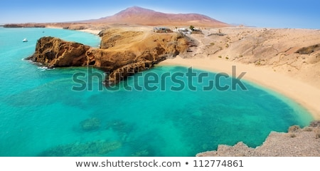 Lanzarote Papagayo turquoise beach and Ajaches stock photo © lunamarina