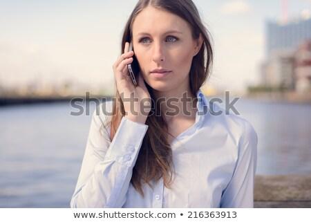 Neutro mulher falante telefone móvel cara cabelo Foto stock © photography33