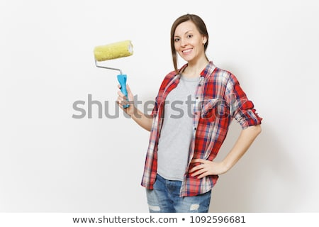 Female decorator holding a paint roller Stock photo © stryjek