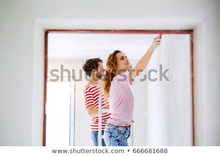 couple painting a room red stock photo © photography33