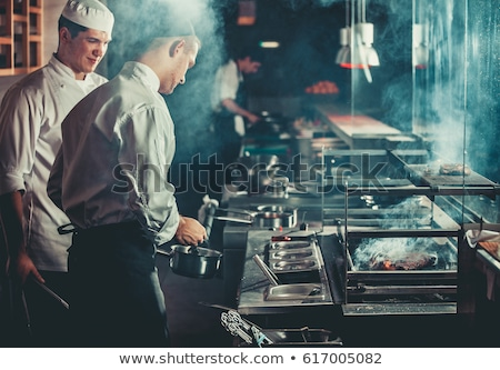 chef monitoring sauce in pan stock photo © photography33