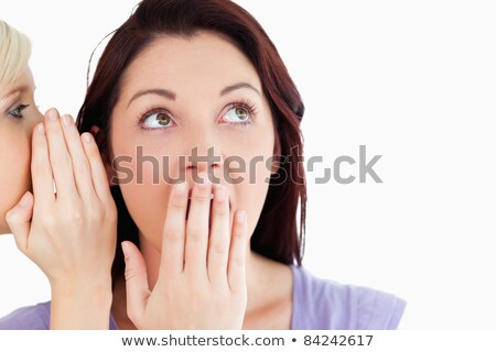 Close up of a shocked women being told a secret in a studio stock photo © wavebreak_media
