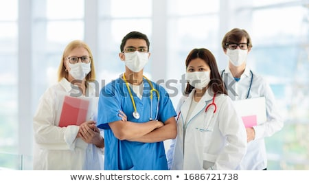 Group of doctors in a meeting at the hospital Stock photo © get4net
