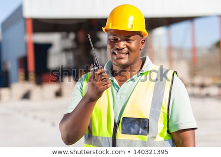 construction site supervisor talking on his walkie talkie Stock photo © photography33