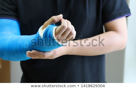 Broken wrist in gypsum Stock photo © ivonnewierink