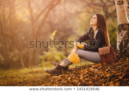 face of beautiful young woman in black blouse Stock photo © ssuaphoto
