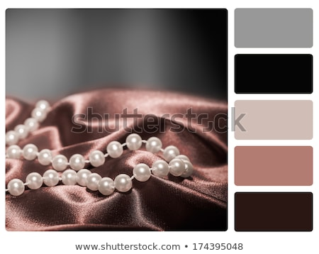 Pearls on a silk colour palette swatch Stock photo © REDPIXEL