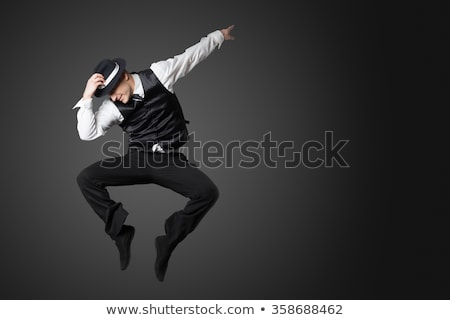 young gangster man jumping isolated on white Stock photo © stepstock