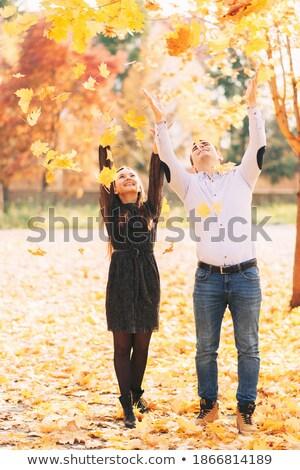 szerető · pár · levelek · ősz · park · égbolt - stock fotó © Geribody