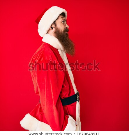 santa man standing relaxed and looking away Stock photo © feedough