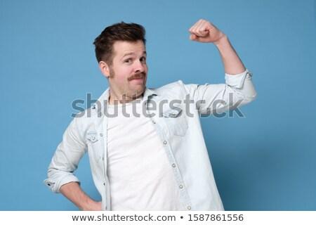 heureux · élégant · jeune · homme · permanent · biceps - photo stock © arturkurjan