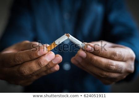 parada · fumar · masculina · puno · cigarrillos · blanco - foto stock © stokkete