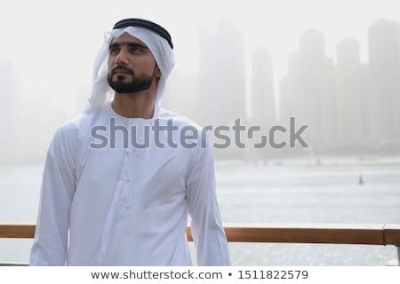 Férfi modell felfelé néz stúdió fehér fal férfi Stock fotó © vanessavr