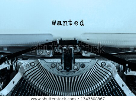 Wanted on Old Typewriter's Keys. Stock photo © tashatuvango