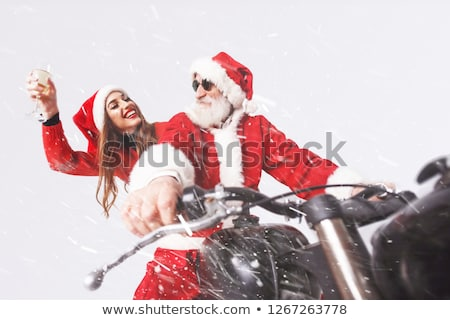 Stock photo: mrs santa with champagne