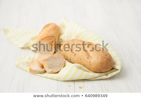 brown long loaf with ears of wheat stock photo © oleksandro