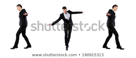 Businessman walking on invisible rope in different directions Stock photo © deandrobot
