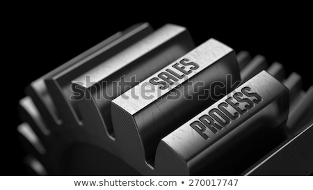 sales process on the metal gears stock photo © tashatuvango