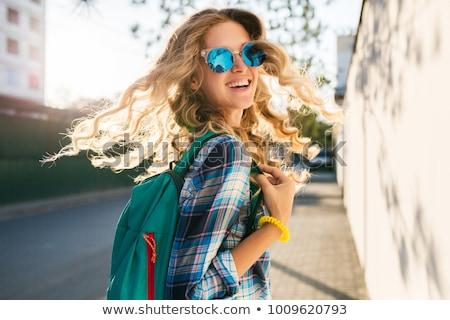 Elegáns fiatal nő trendi póló közelkép derűs Stock fotó © juniart