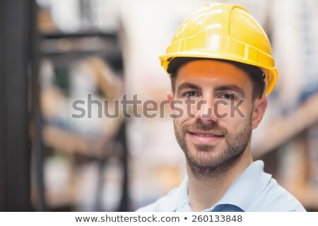 Close up of worker wearing hard hat in warehouse Stock photo © wavebreak_media