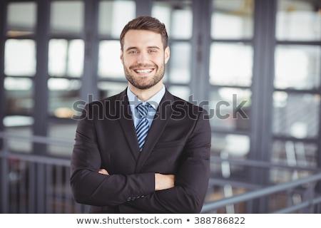 empresário · sorridente · câmera · jovem · homem · de · negócios - foto stock © wavebreak_media