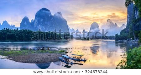 Kalksteen heuvels mist China zonsopgang natuur Stockfoto © EcoPic