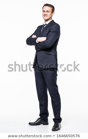 Happy businessman standing with arms folded Stock photo © deandrobot