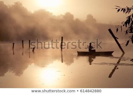 Vissersboot rivier stralen dawn lege rubber Stockfoto © AlisLuch