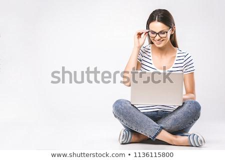 Stock photo: Portrait of a smiling beautiful woman using laptop