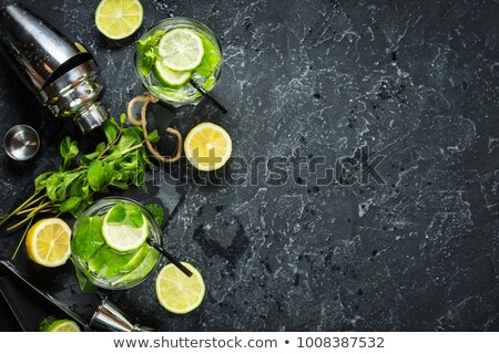 Cocktail Caipirinha on black board Stock photo © netkov1