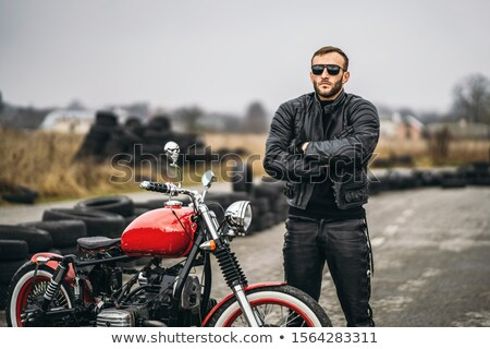 motorcyclist standing on country road near bike Stock photo © Paha_L